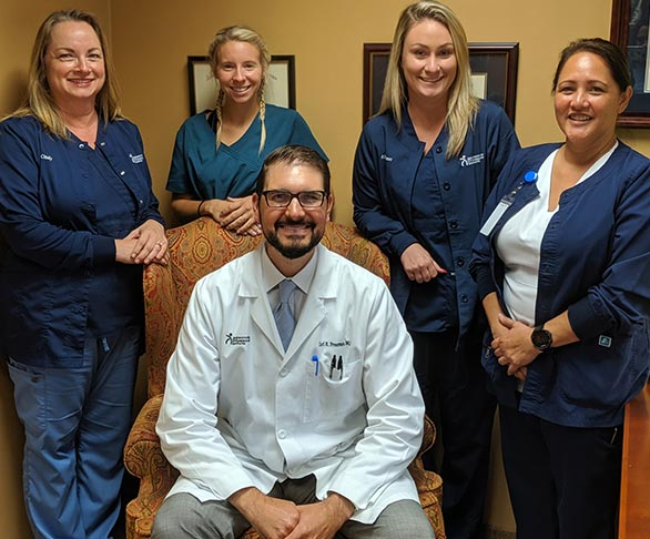 Freeman, M.D. with his Staff